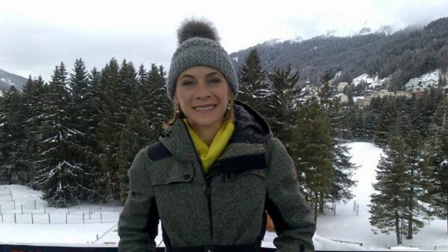 CNN's Nina Dos Santos can be getting ready for her live shot within Davos.