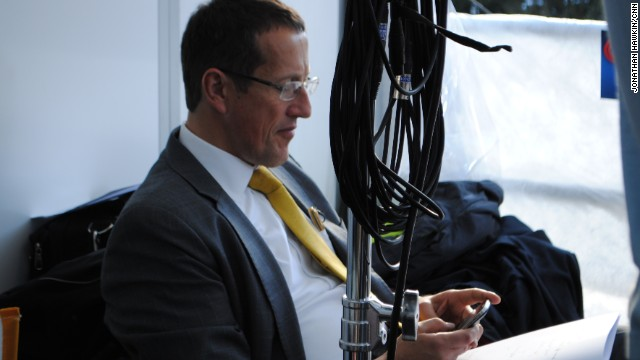 Richard Quest having a quiet moment prior to going about air with Davos.
