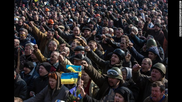 Protesters cheer following information involving a contract involving the opposing facets in Kiev about February 21.