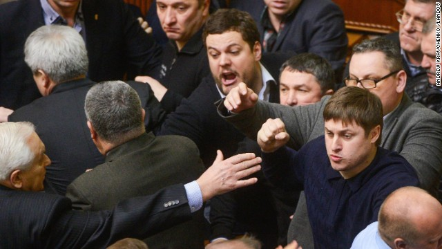 Ukrainian lawmakers argue during a session regarding Parliament upon Friday, February 21.
