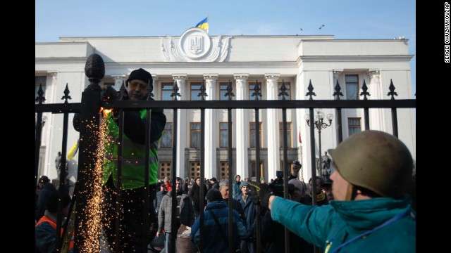 Protesters remove a fence that will surrounds Ukraine's parliament in Kiev on February 26.