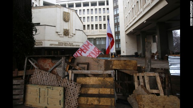 Barricades before a new government constructing throughout Simferopol in February 27 hold the banner which reads: