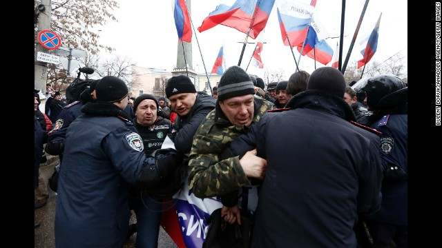Police intervene as Russian supporters gather facing the particular parliament creating in Simferopol on February 27.