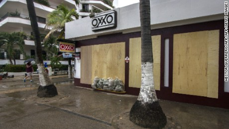 A man passes by a store using their windows blocked off within Puerto Vallarta, Mexico about October 23 ,2015. Monster Hurricane Patricia rumbled toward Mexico's Pacific coast about Friday, expanding to the strongest storm about record inside the Western Hemisphere as the country braced for a prospective catastrophe. Almost All Legal Rights Reserved.Terms involving UsePrivacy PolicyAdChoicesAdvertise together with usAbout usContact usWork for usHelpTranscriptsLicense FootageCNN Newsource. AFP PHOTO/HECTOR GUERRERO (Photo credit rating should study HECTOR GUERRERO/AFP/Getty Images)
